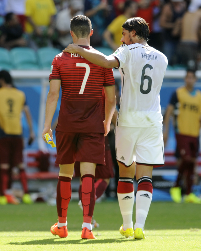 Portugal s Cristiano Ronaldo (7) walks off the pitch with Germany s Sami  Khedira (6) at the half during the group G World Cup soccer match between  Germany ... 4423c943b