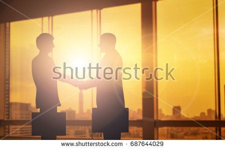 silhouettes two businessmen handshake in cooperation agreement - business partner agreement