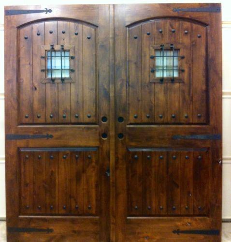 Rustic entry door arch top panels with speak easy doors for Exterior wood double french doors
