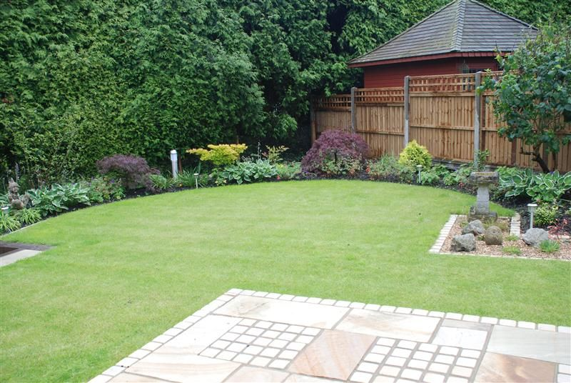 Curving Lawn With Mint Sandstone Patio