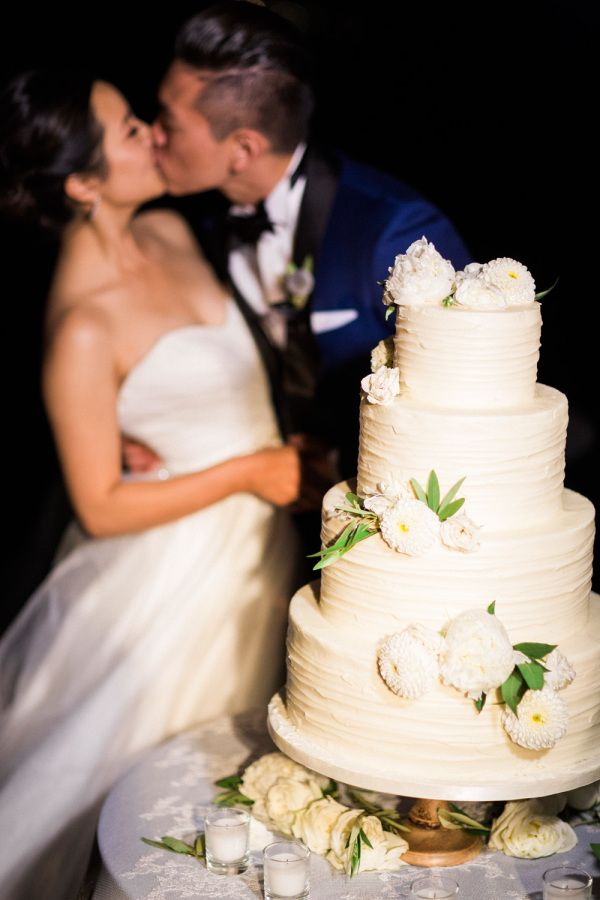 4 tier wedding cake with white flowers