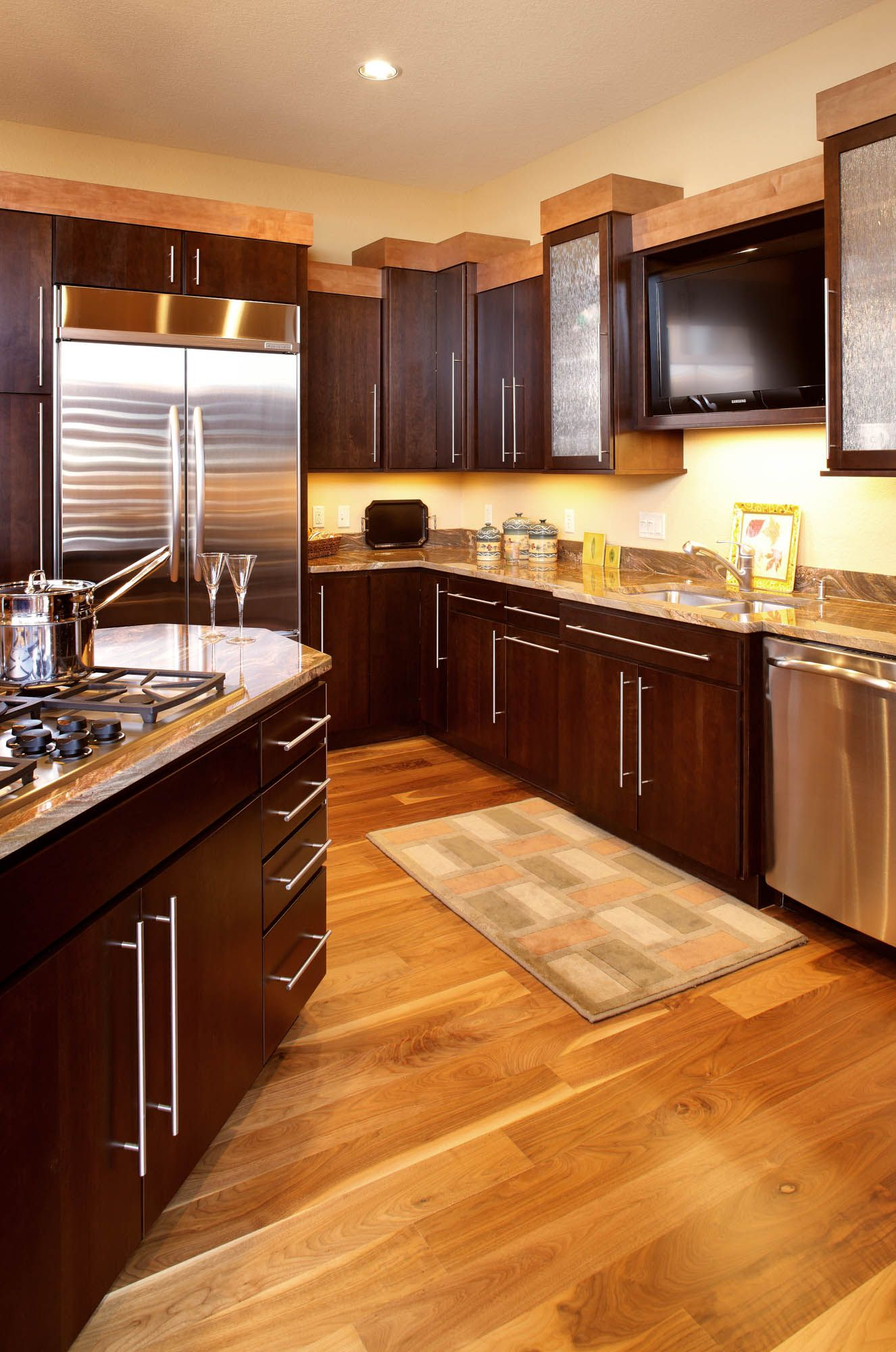 Stained Kitchen Cabinets In Coffee And Hazelnut By Showplace Cabinetry View 2 Kitchen Cabinets Kitchen Cabinet Colors Stained Kitchen Cabinets
