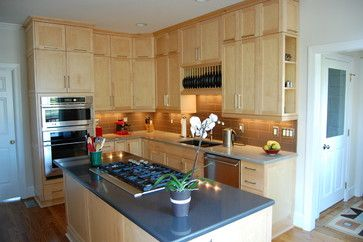 This contemporary kitchen features double stacked natural ... on Natural Maple Cabinets With Quartz Countertops  id=34766