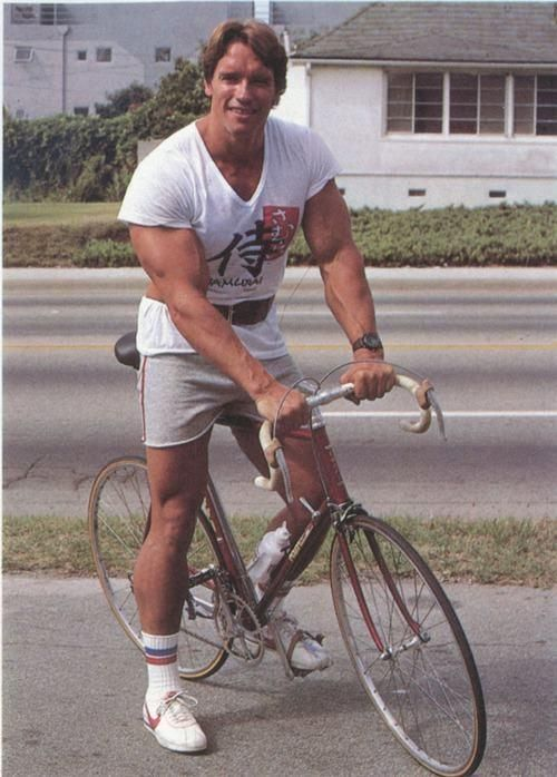 Young Schwarzenegger with Road Bike.