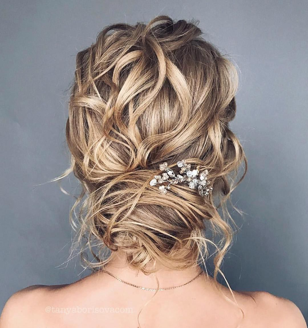 Messy updo wedding hairstyle