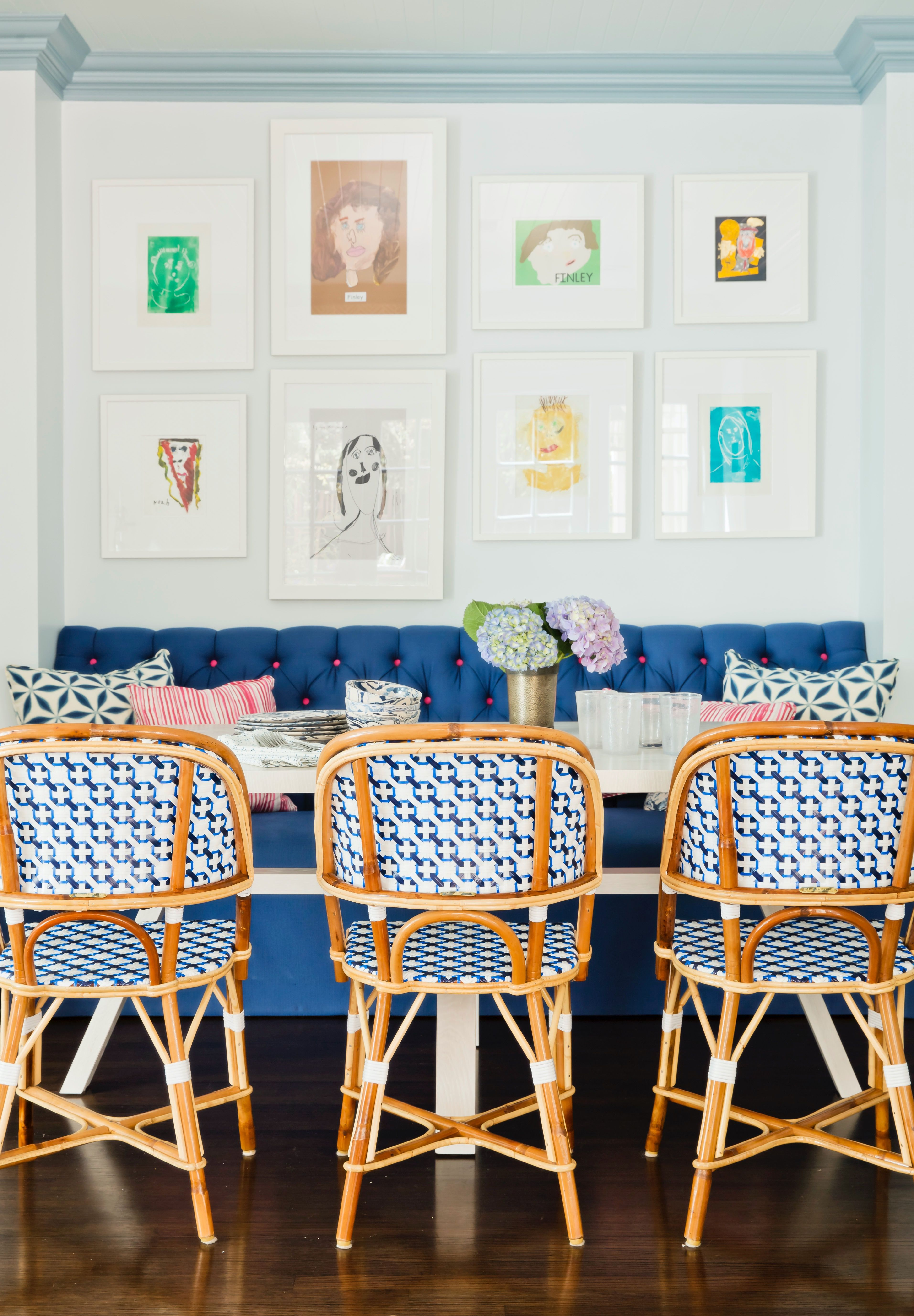Love this home interior with kid art above the kitchen banquette. #homeinterior #kitchen #interiordesign