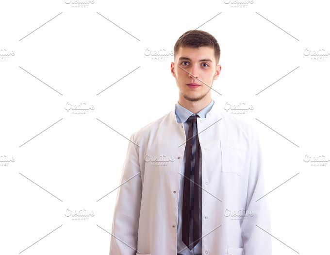 Young man in doctor gown Photos Young attractive man with brown hair ...