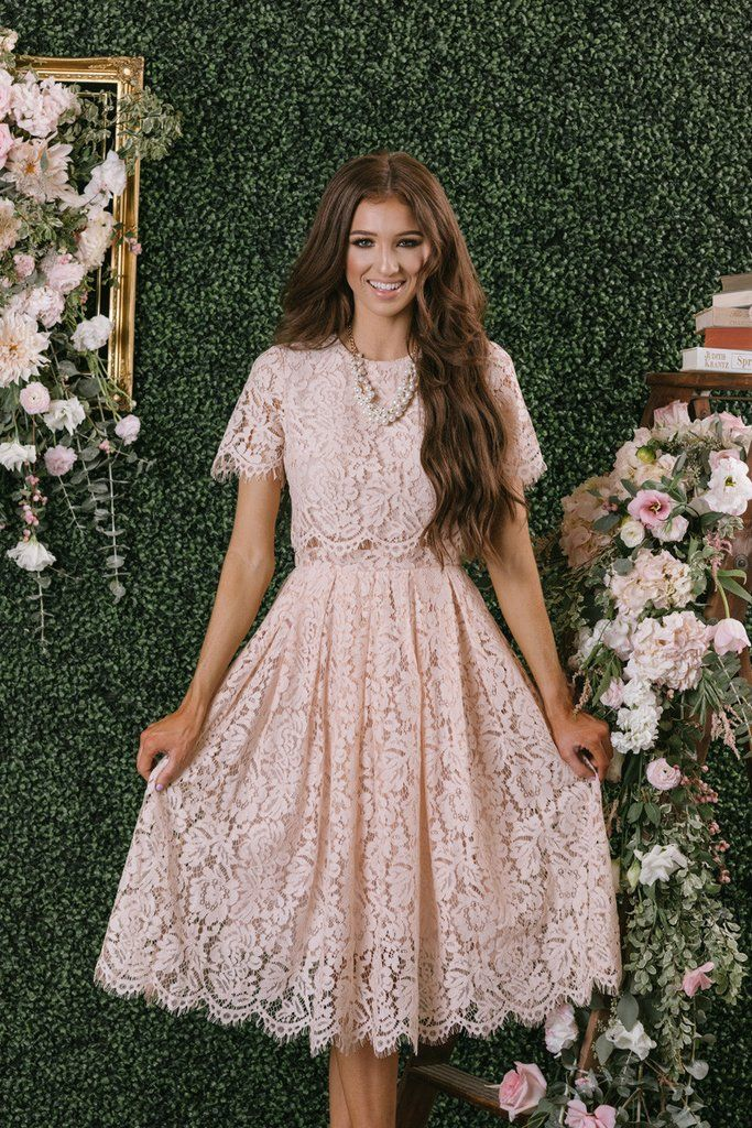 a1530782ccb0 We finally found the dress of our dreams! This short sleeve blush midi dress  is flattering, romantic, and just plain.