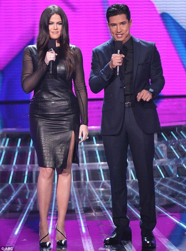 I wore it first! Khloe seen here co-hosting the show earlier this month with Mario Lopez