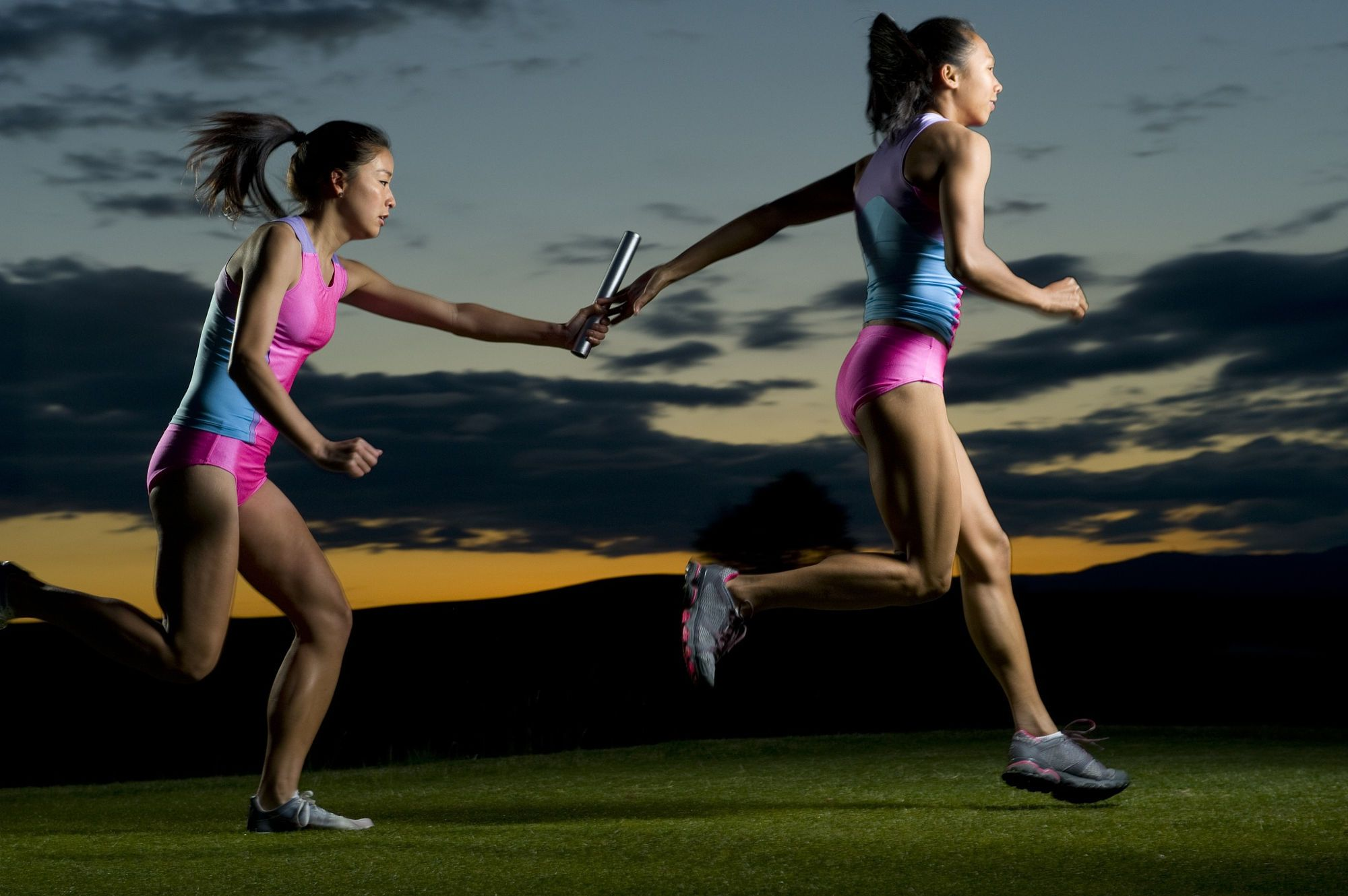 Relay runners passing baton in competition | Sport portraits, Competition, Relay