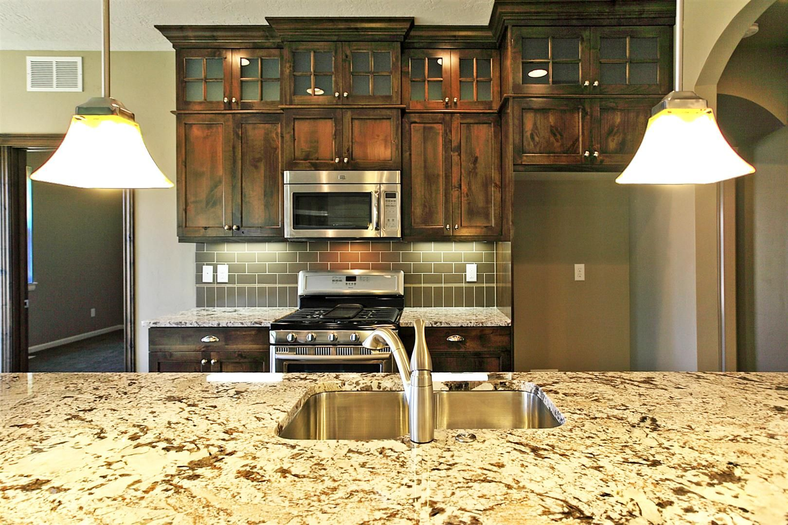Mission Oak stained shaker style cabinets with satin ...