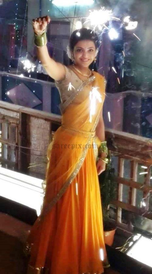 Kajal Agarwal In Orange Half Saree Images From Maari Movie Half Saree Saree Half Saree Lehenga