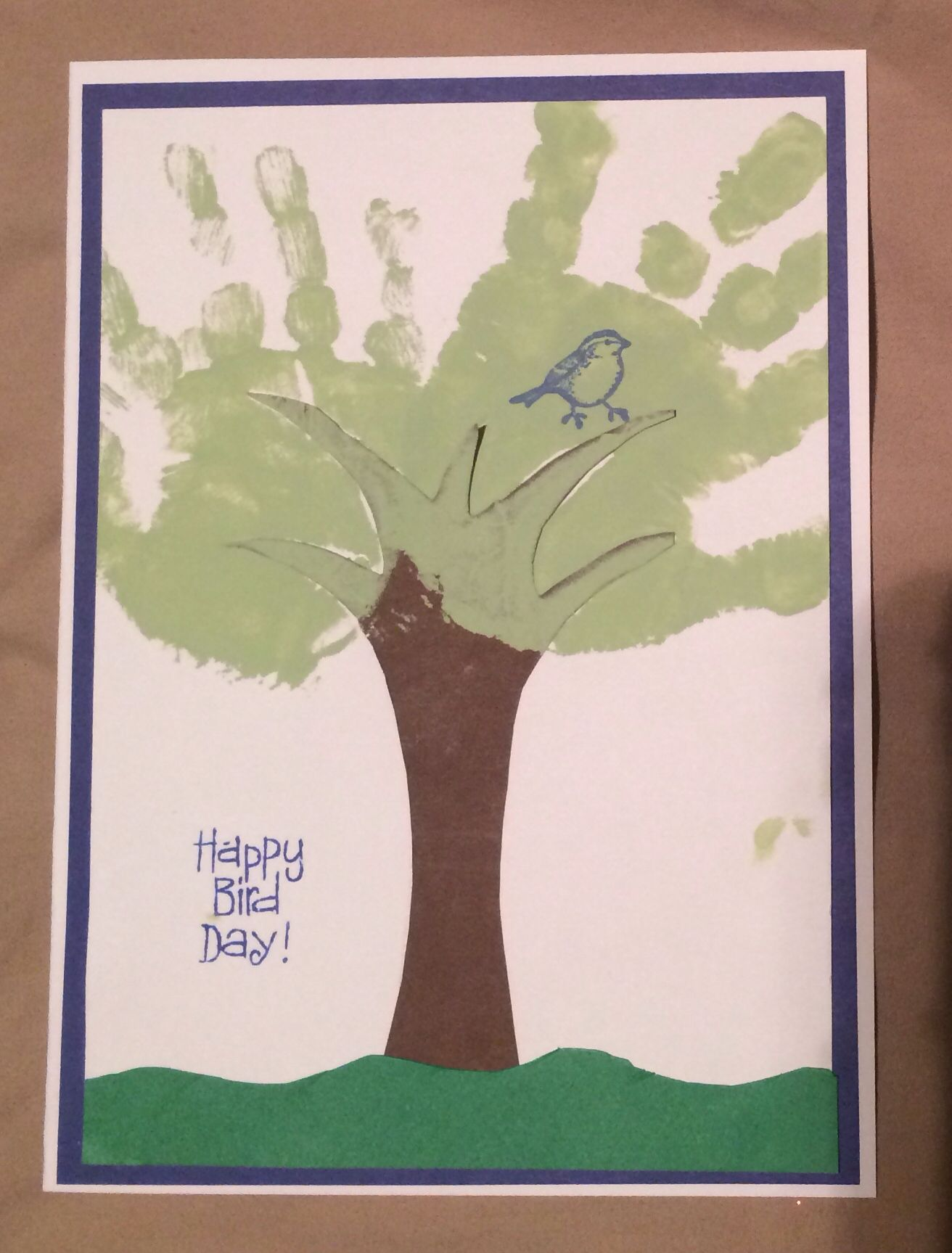 We made this tree handprint card for grandpaus birthday the tree
