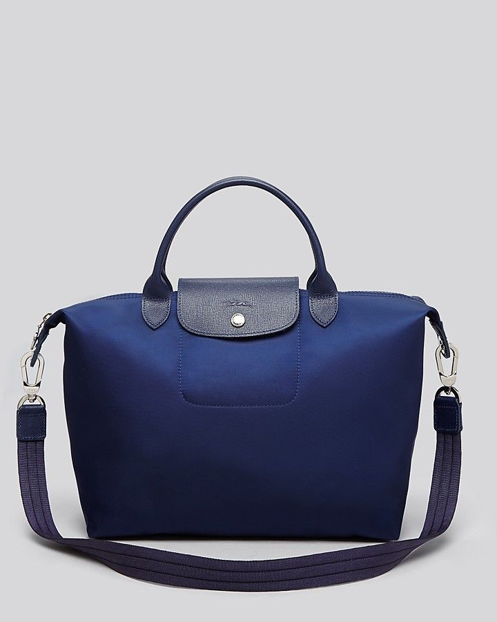 Longchamp debuts an all-new iteration of its much-loved Le Pliage tote  the  Neo pairs textured leather trim with the French house s signature  lightweight ... dd5fd136c8246