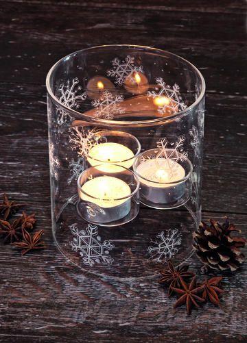 Glaszylinder mit Schneeflocken
