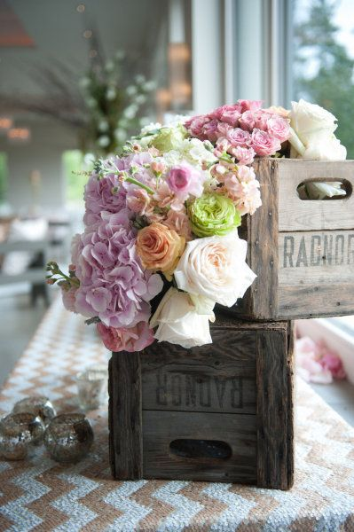 I love the combination of modern and rustic with the sparkly chevron table cloth and the wooden crates filled with gorgeous flowers! From http://stylemepretty.com/gallery/picture/787156  Photo Credit: http://ambphoto.com/