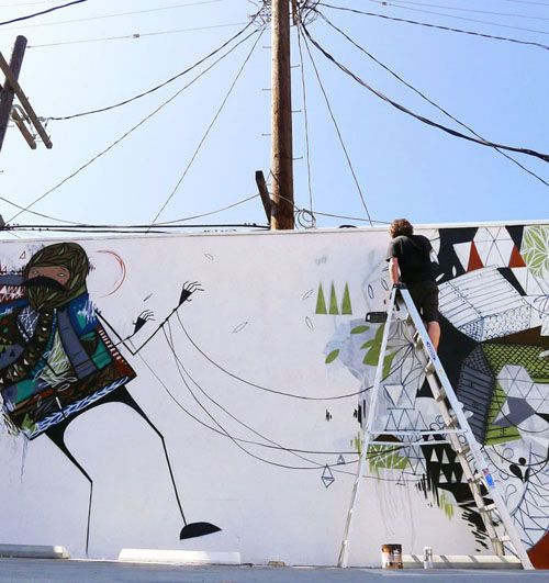 artist creepy in los angeles. tied to telephone wires.