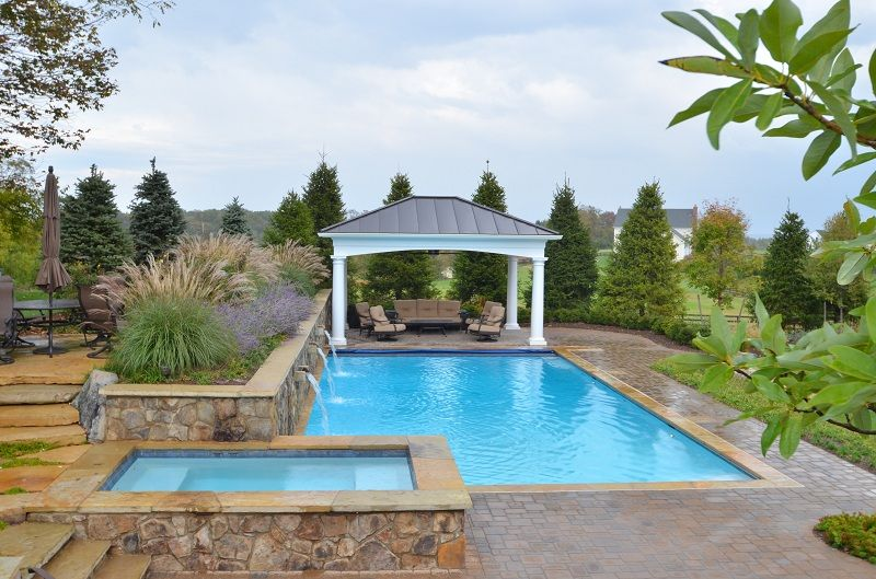 Pebble fina bella blue purcellville virginia rectangle pool pergola raised spa water - Rectangle pool with water feature ...