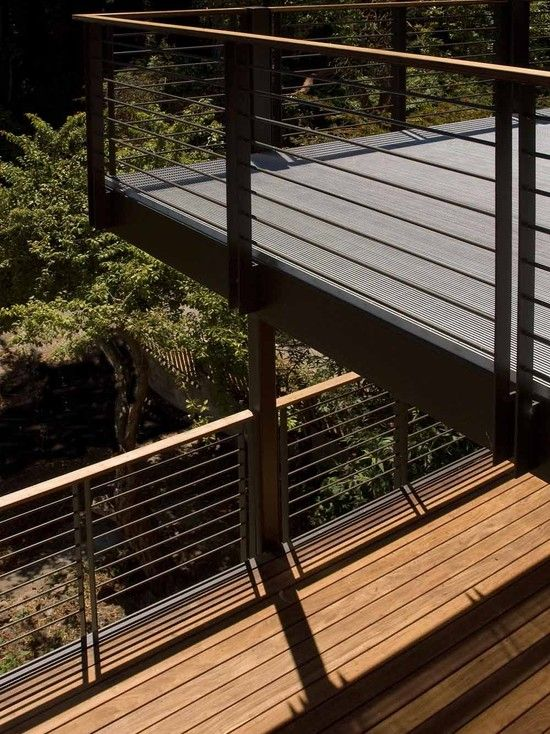 horizontal metal railing with flat top board