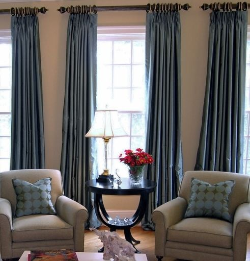 Blue drapes with neutral chairs/floor. BBB has nice grommeted drapes ...
