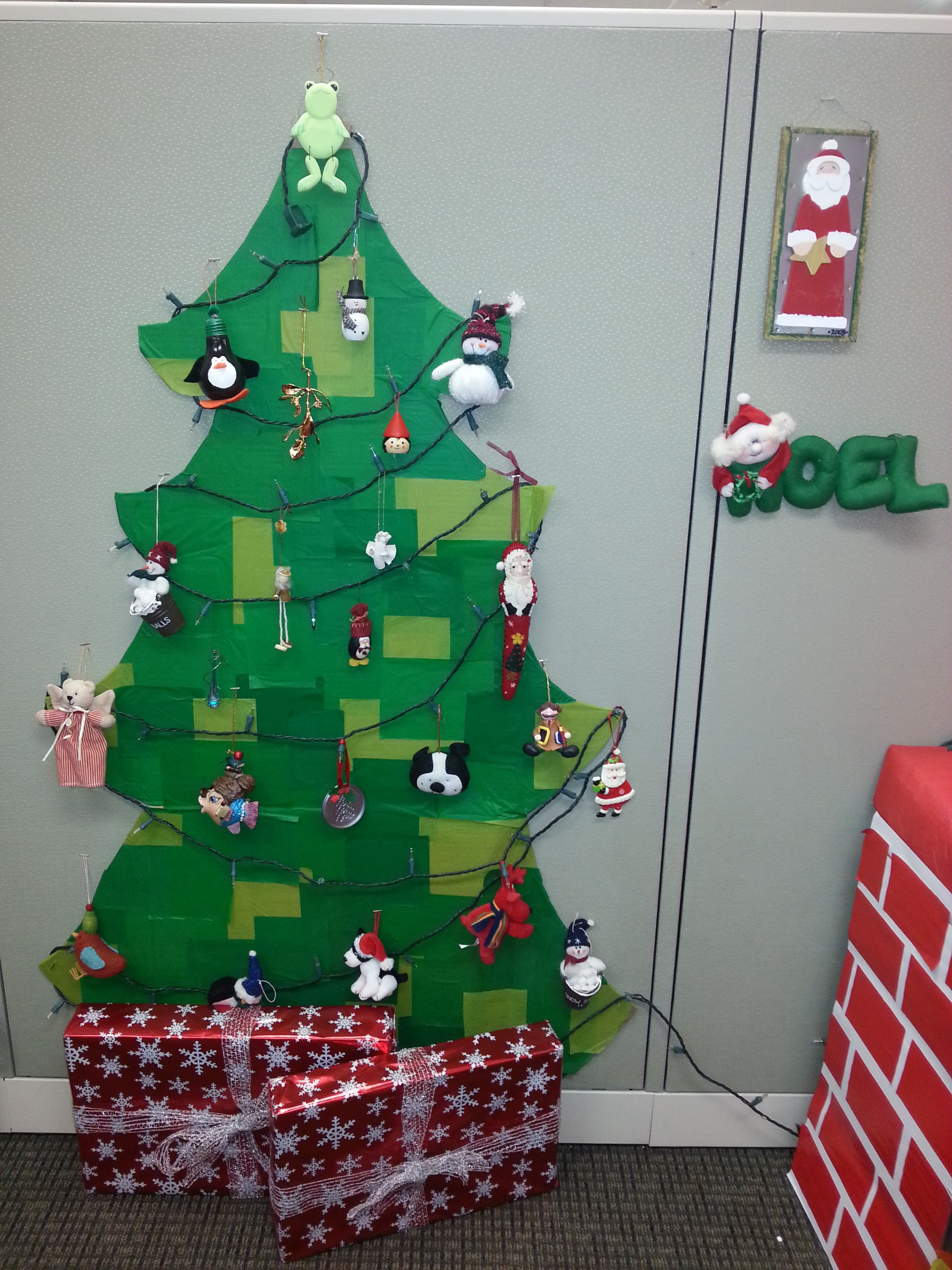 Cubicle Christmas tree made from a large piece of cardboard covered ...