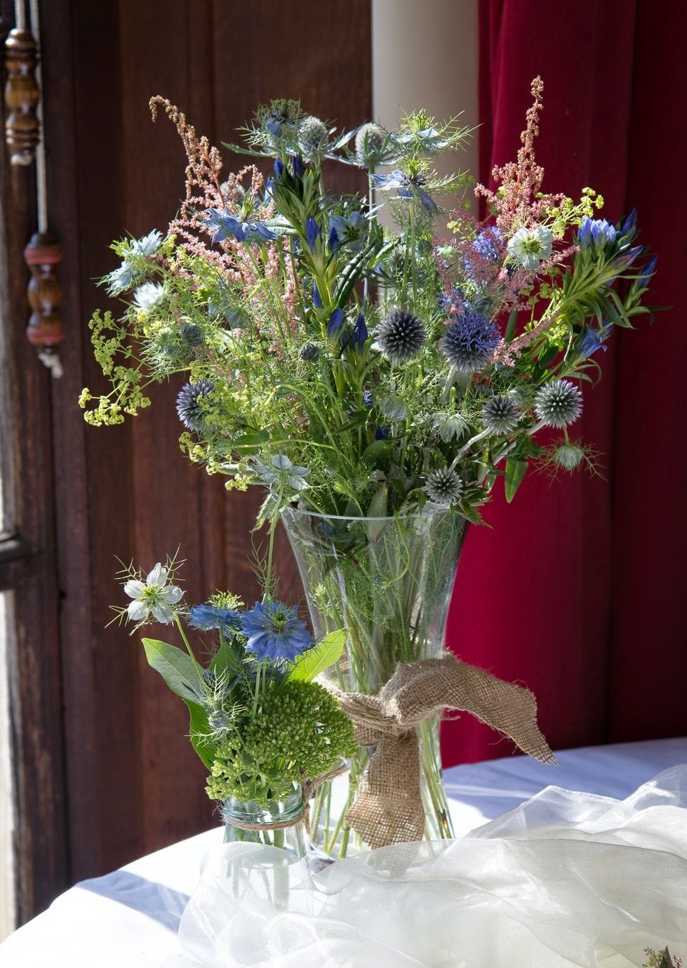 Natural styled table vase of wild flowers including eryngium natural styled table vase of wild flowers including eryngium echinops astilbe izmirmasajfo