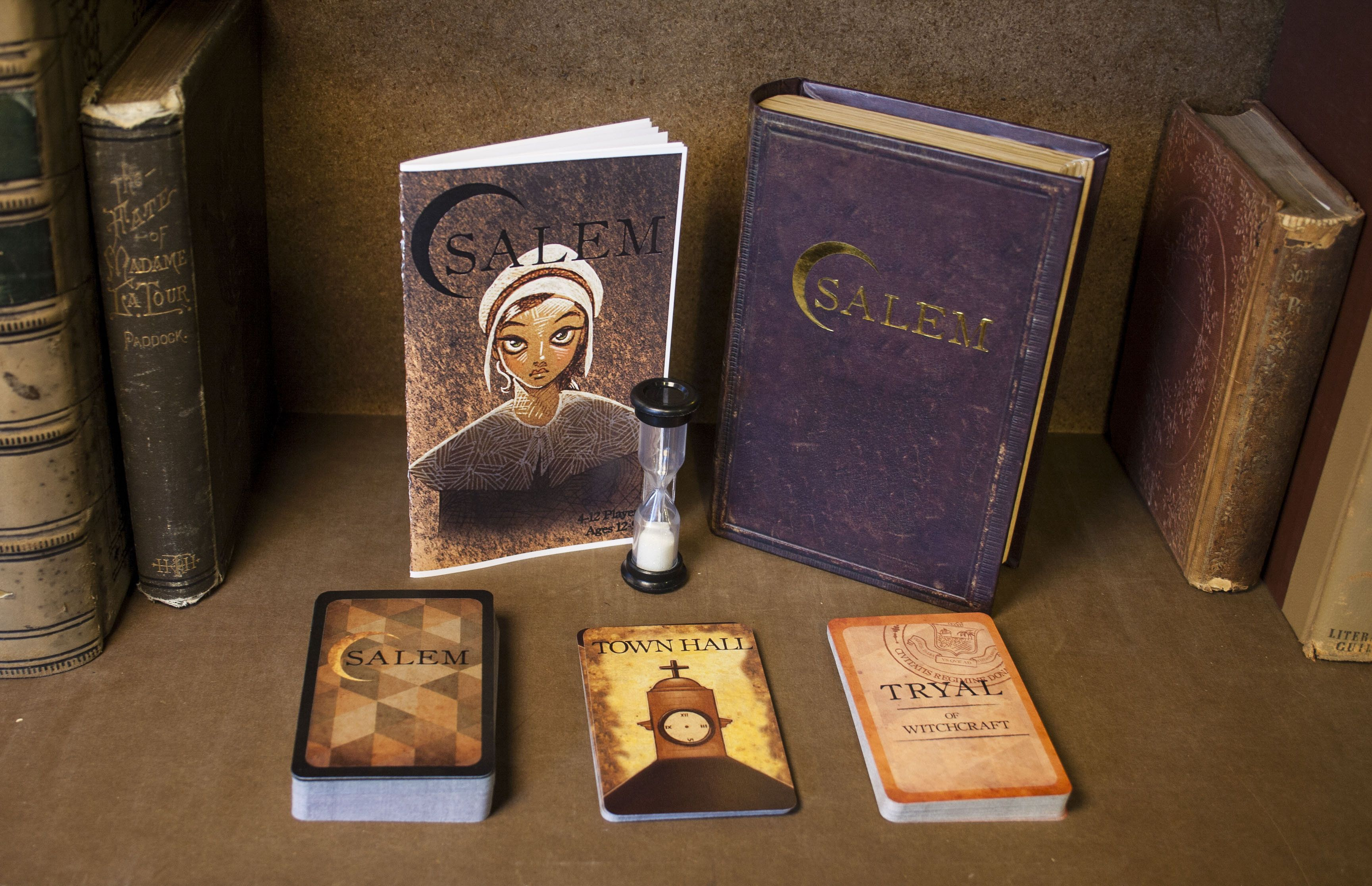 Salem Witch Trials card game. Uses fake book for game box