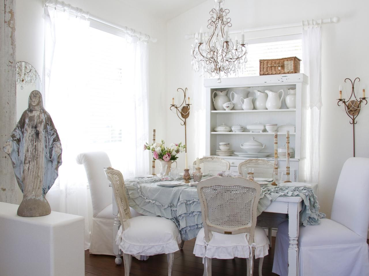 This All White Shabby Chic Dining Room Features A Ruffled Tablecloth,  Vintage Cane Back Chairs And Antique Accessories, Including A Beautiful  Display Of ...