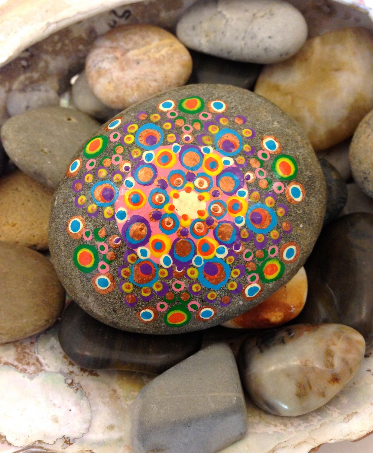 "Mandala Stone ""Cosmic Rainbow"" Pink, Green, Orange, Blue, Purple, Yellow, Copper Hand Painted Dot Work Design Beach Stone by BlueLotusHemp on Etsy https://www.etsy.com/listing/209857210/mandala-stone-cosmic-rainbow-pink-green"