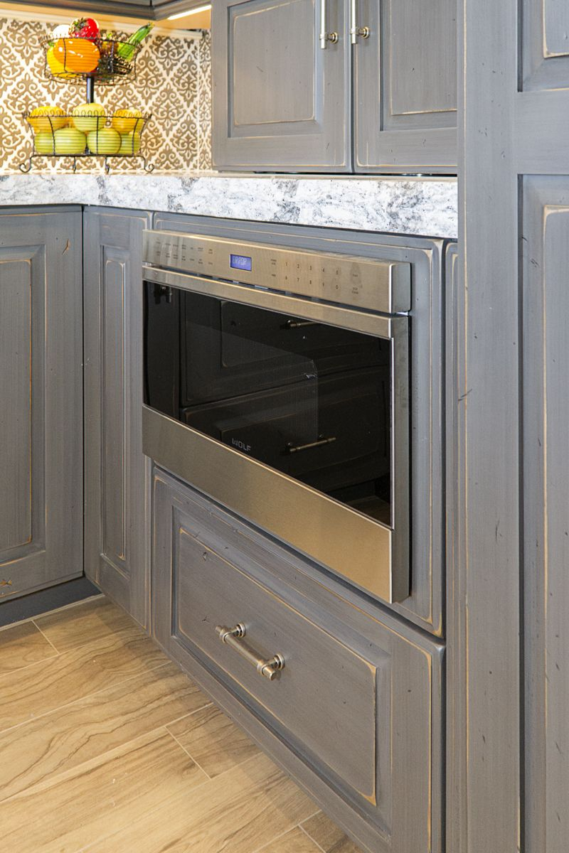 Frameless Kitchen Cabinets With Portsmouth Door Style In Knotty Alder Sawyer Smoke Stack Finish