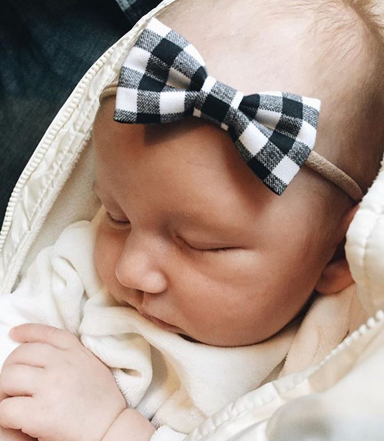 Bringing baby home in a black gingham bow