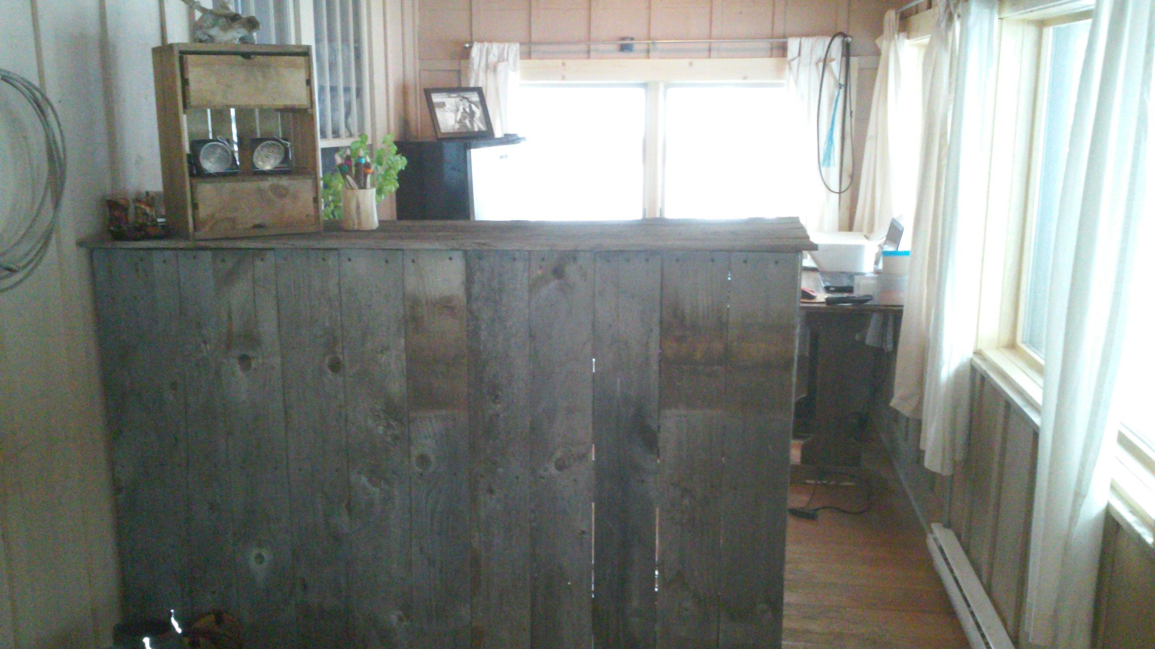 """Barnwood Office Desk complete! Went 48"""" high, made the interior and back out of 2x4s and covered it with barnwood. ERGR buckles showcased and offers the first welcome to guests as they enter house."""