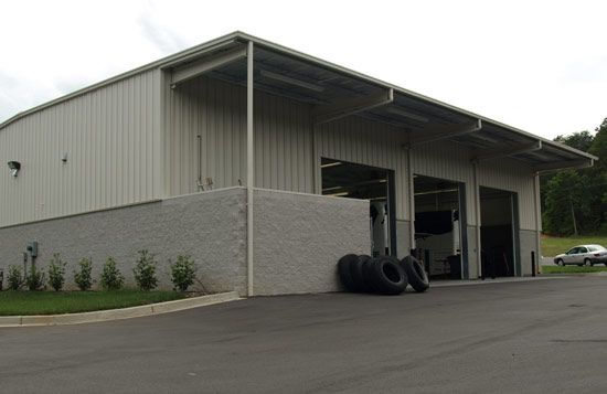 Champion Coach built state-of-the-art, 8,500 sq ft, pre-engineered bus maintenance shop with a full length pit for bus service, polished concrete floors and six power-operated roll up doors for the safety and efficiency of our mechanics.
