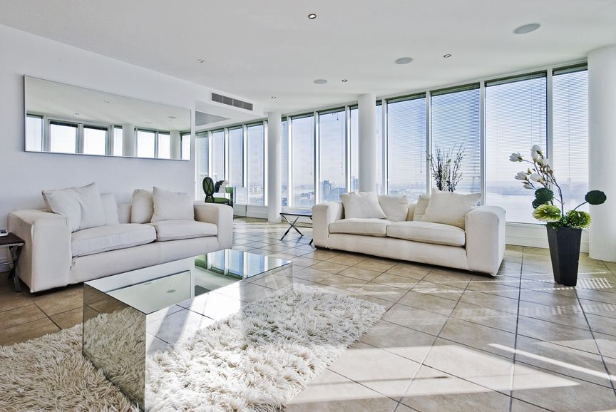 Large Apartment Modern Living Room With White Furniture And Floor To Ceiling Windows Living Room Design Modern Living Room Designs Mirror Wall Living Room
