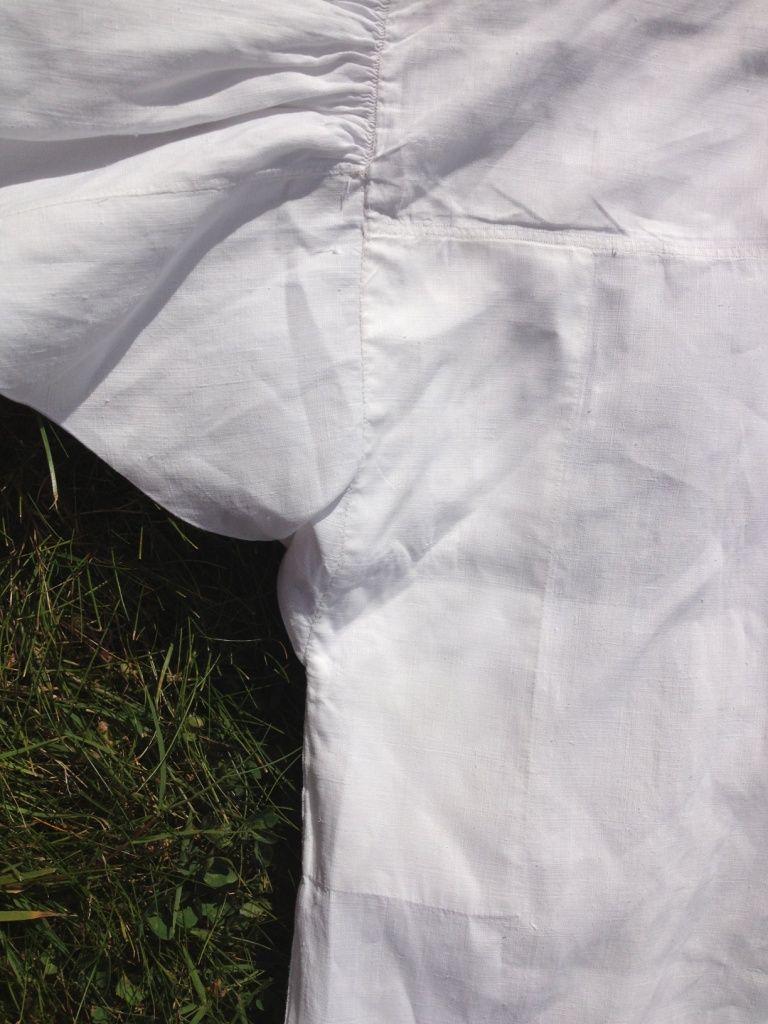 Early 19thC linen shirt. Underarm detail. Triangular insert and rectangular reinforcement.