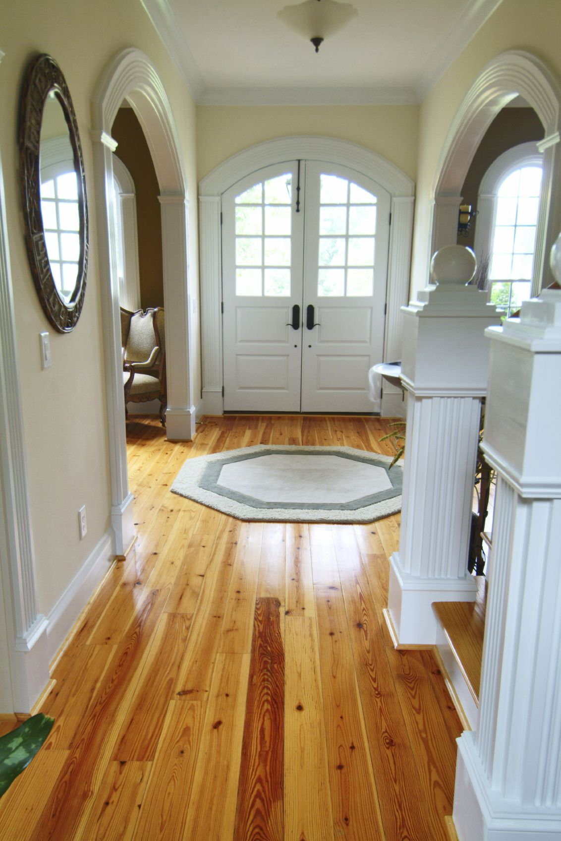 This Narrow Foyer Opens Immediately Into Two More Rooms On The Left And Right Of Door White Wood Staircase Leading Up To Second Floor Comes