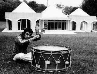 "The Who's drummer Keith Moon at ""Tara"" his home in Chertsey Surrey, England. Tara, on St. Anns Hill, was a one-storey, four-bedroom bungalow, approximately 1,100 sq feet. The roof peaked in five pyramids, one on each corner of the house and one in the centre over a large sunken lounge. It was demolished and replaced by a new home in 1990."