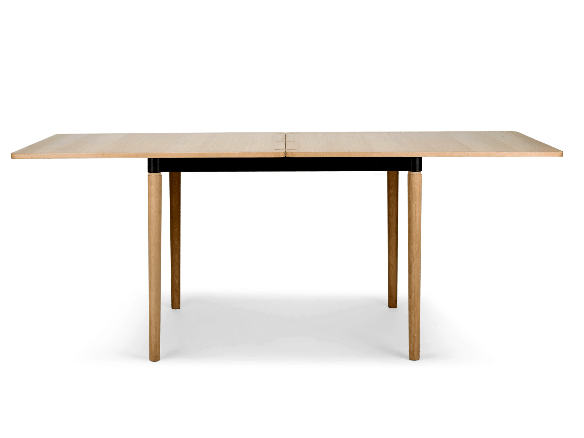 The DoubleUp dining table oak by Bolia boasts a top finish in