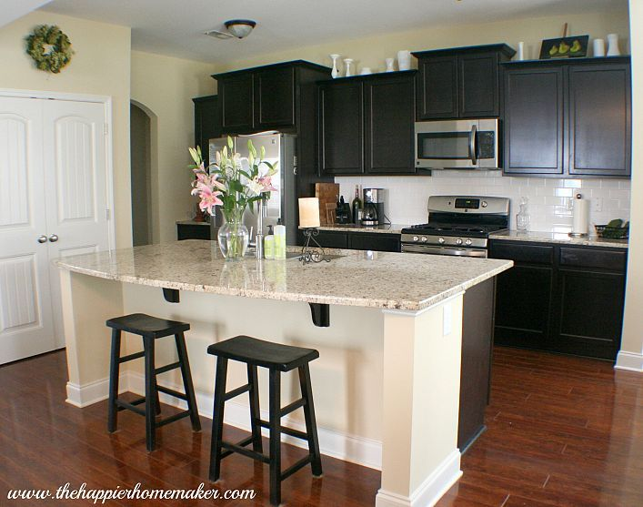 Espresso kitchen cabinets with cherrywood floor and ...