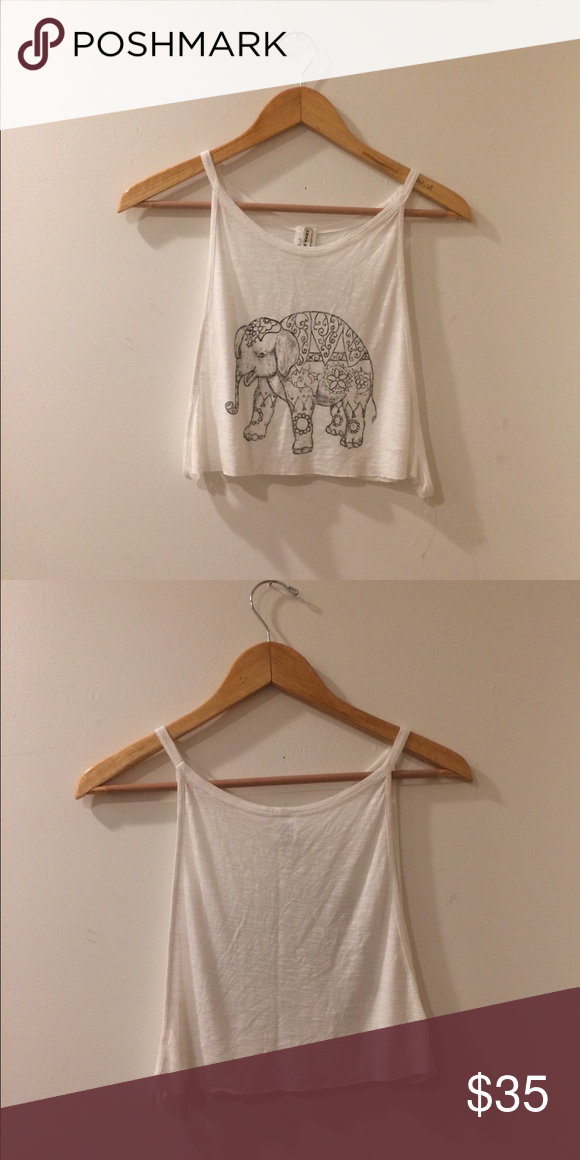 84444a47b LF White elephant crop top LF Emma   Sam white elephant crop top. Arm holes  are open. Perfect with a bralette. Brand new without tags LF Tops Crop Tops
