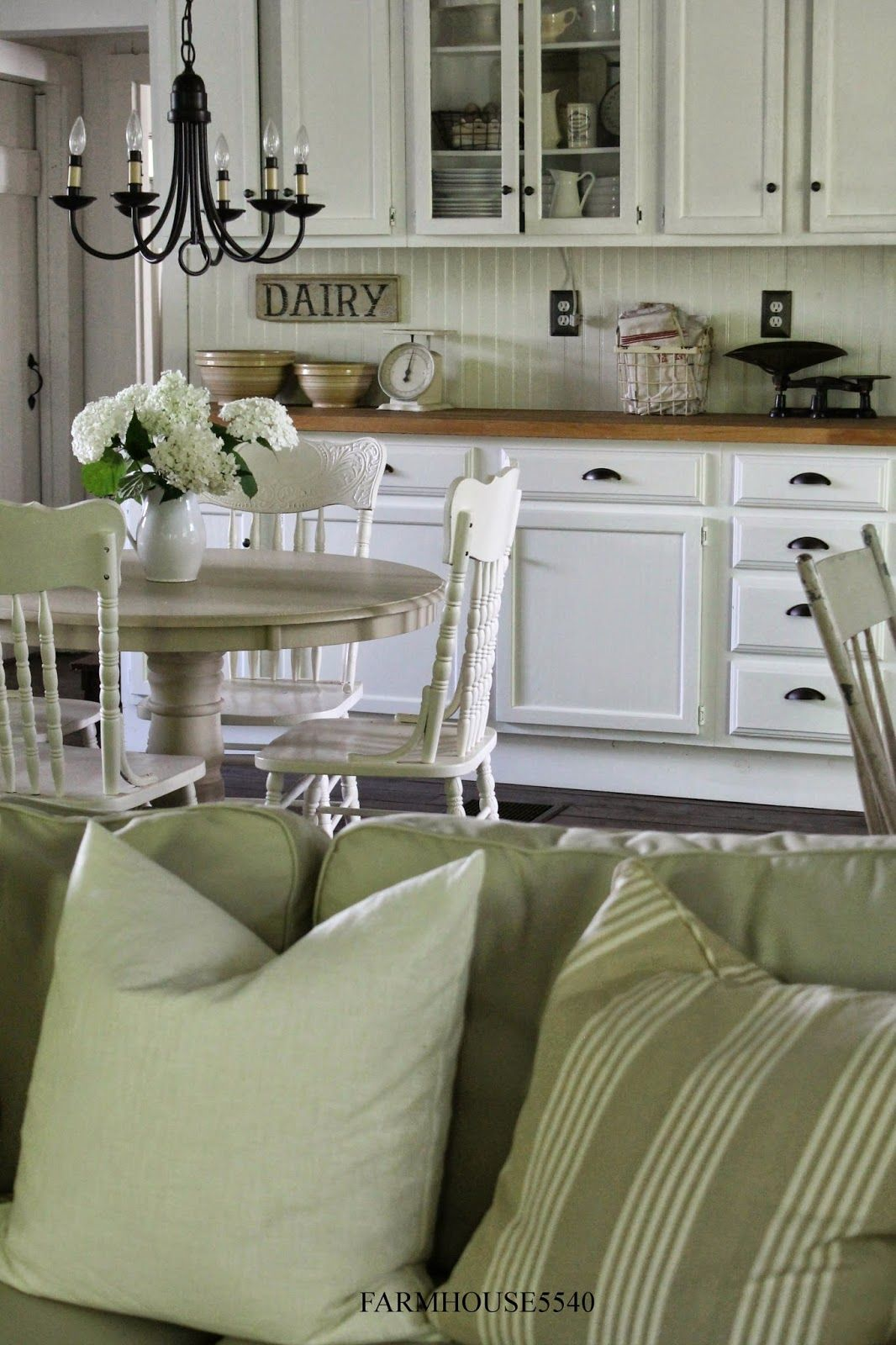 """FARMHOUSE 5540 - Love the dairy sign, the wooden counters and the painted Victorian pressed-back chairs....They all spell """"H-O-M-E"""""""