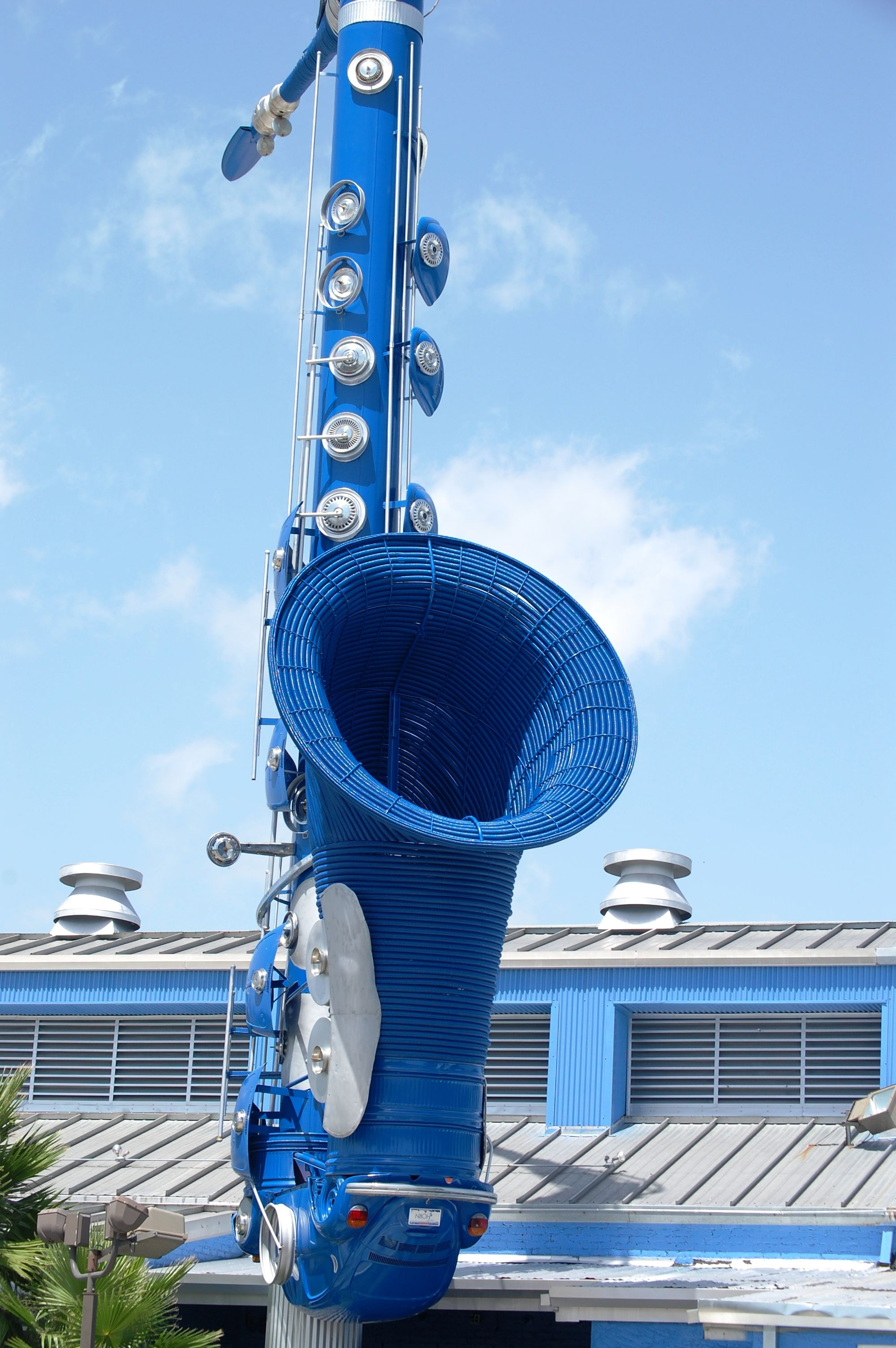 Giant blue saxophone made out of volkswagen parts