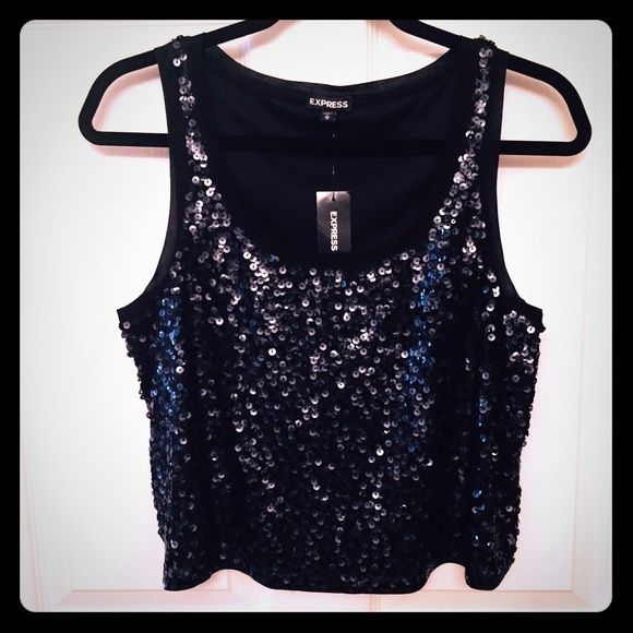 NEW EXPRESS ALL BLACK SEQUENCE CROP TANK NWT BLACK CROP TANK WITH SEQUENCES ALL OVER... with material lining the neck & arms.. no itching  Express Tops Tank Tops