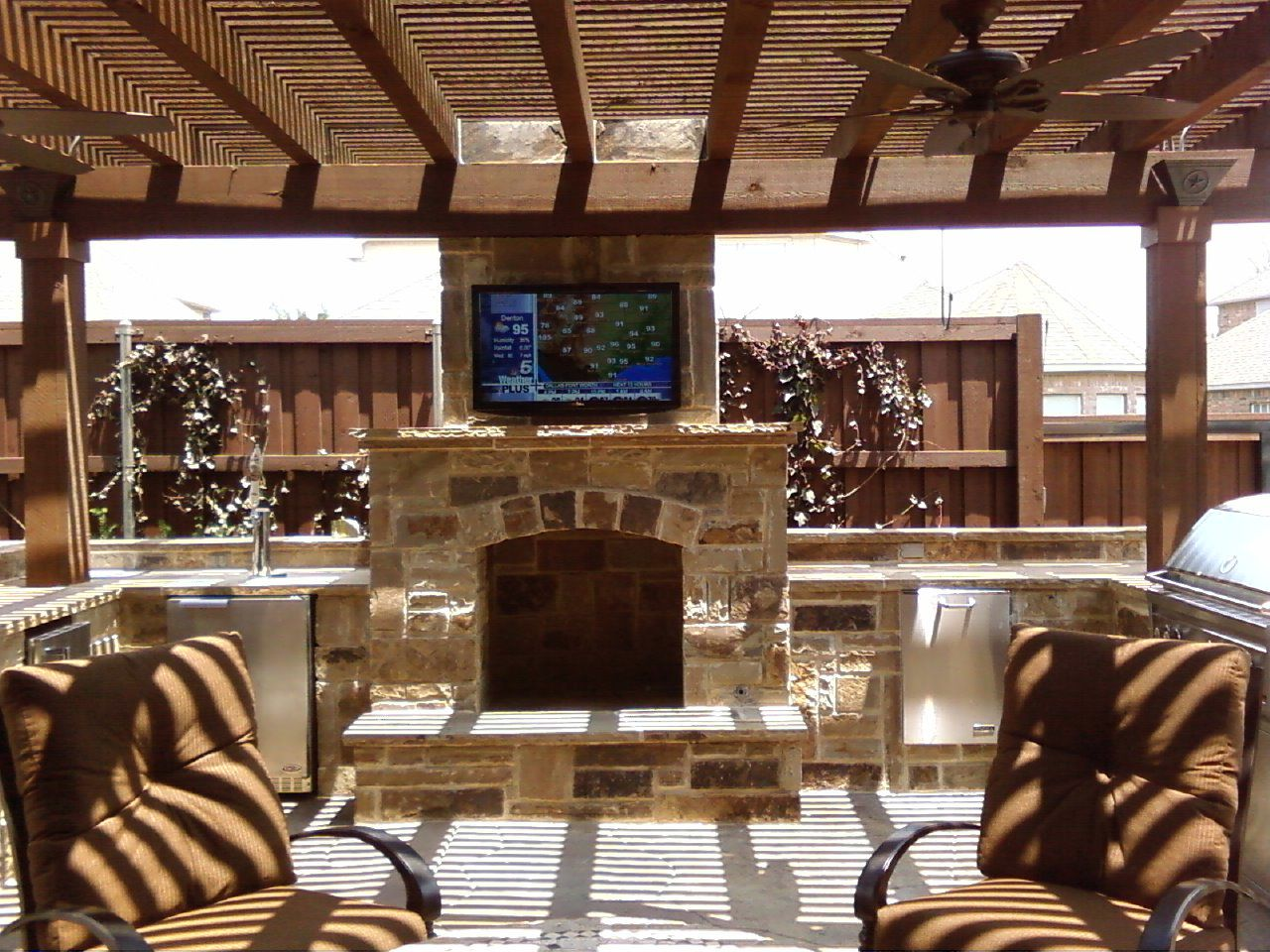 Captivating Patio: Extended Room With Built In Kitchen Appliances, Master Grill, Flat  Screen TV, And Beautiful Stone Fireplace.