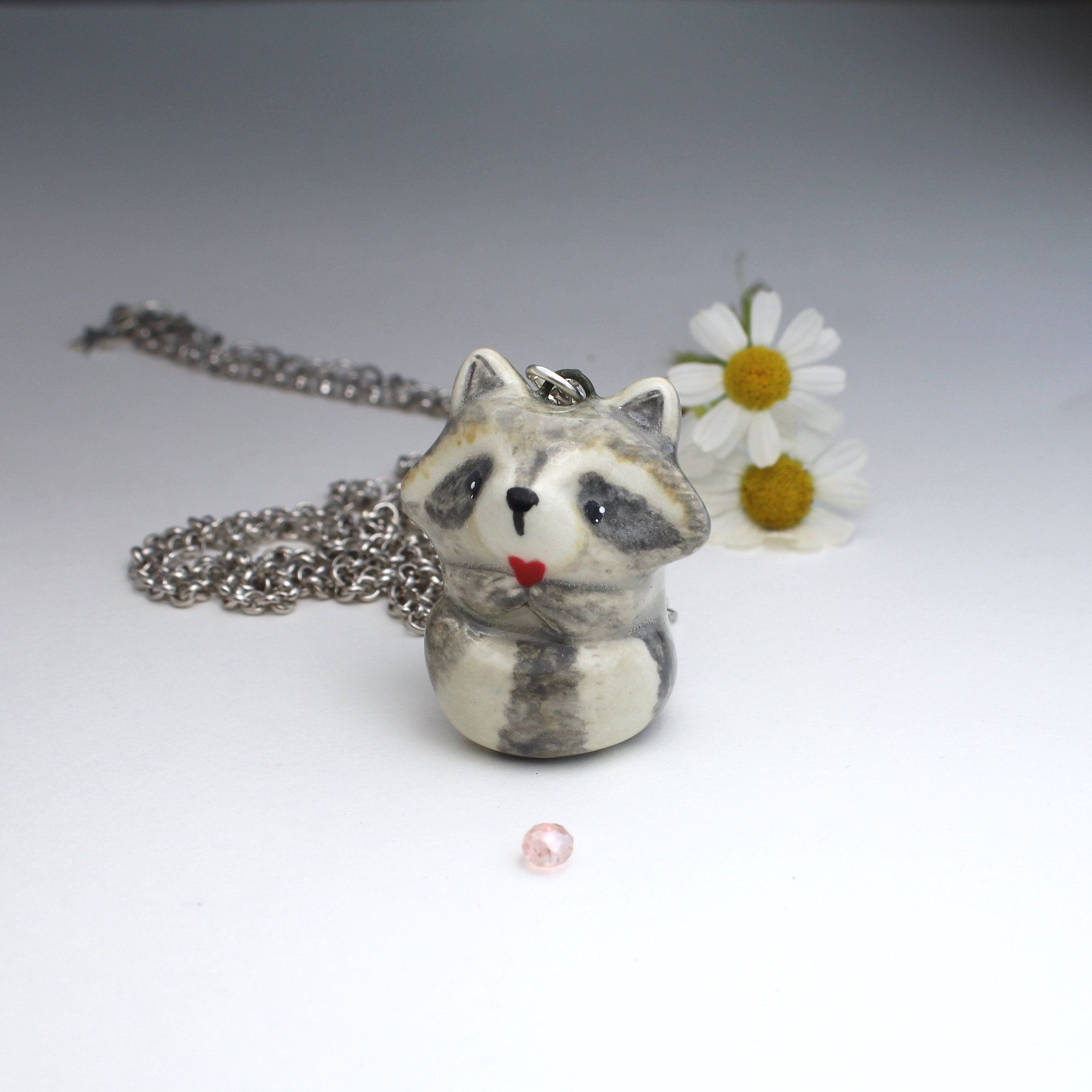 Raccoon Holding Red Heart Necklace Handmade Ceramic Pendant With Rhodium Dipped Rolo Chain In 2020 Red Heart Necklace Ceramic Pendant Handmade Ceramics