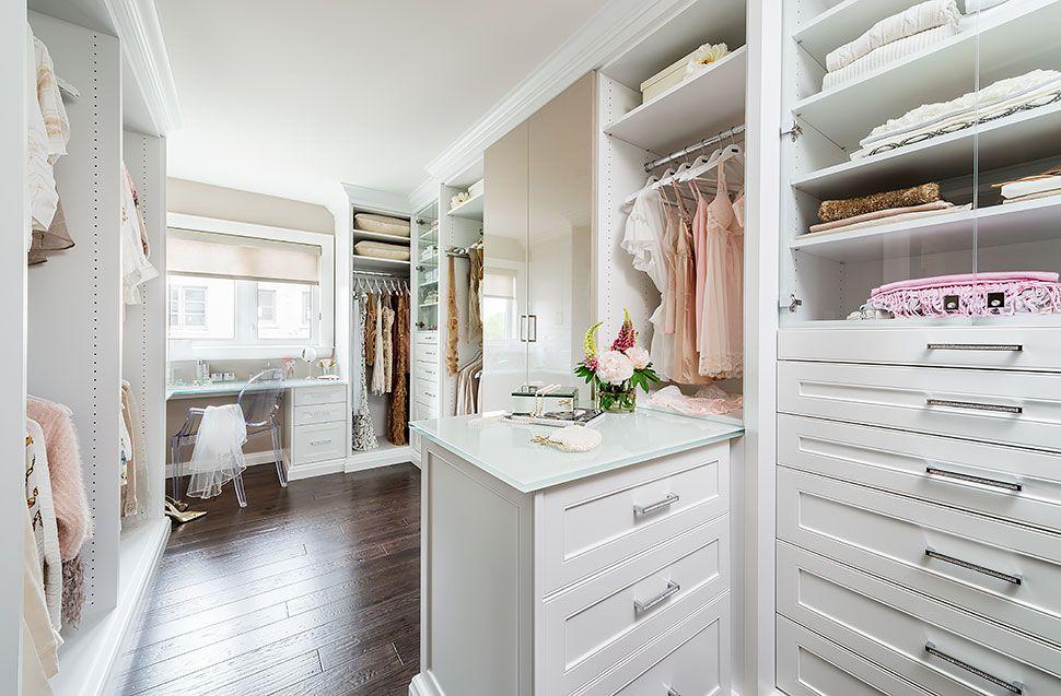 White dressing room walk-in closet with plenty or storage ...