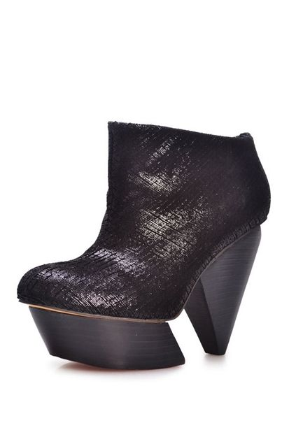 The booties have been crafted in cowhide, featuring textured snake skin pattern styling, high platform, notched high heel.$129