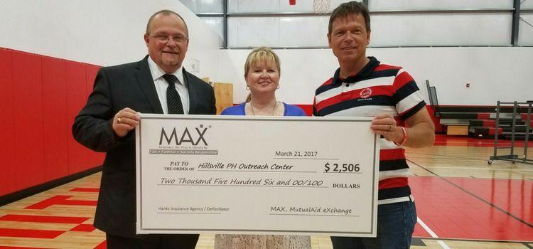 Hanks insurance and max donate defibrillator to hillsville