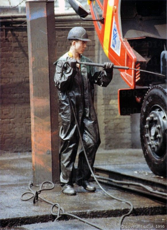 Picture of Truck Washers, wearing dirty green waterproof PVC ...