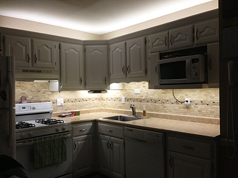 attractive Led Strip Lights For Under Kitchen Cabinets #2: White Balance LED Flexible Light Strip used to outfit kitchen cabinets with  over and under lighting